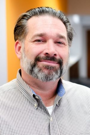 Ed McMasters, Director of Marketing and Communications for Flottman Company's miniature folding and miniature printing projects.